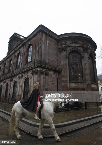Stunt rider Emily Cox posing as Lady Godiva riding Legend through St Ann's Square Manchester
