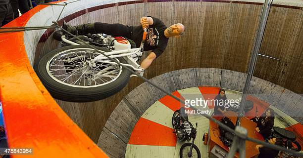 A stunt rider performs on the Wall of Death an attraction at the Royal Cornwall Show on the opening day of the show near Wadebridge on June 4 2015 in...