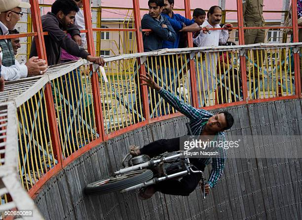 Stuntman attempts to grab and receive money from a spectator.