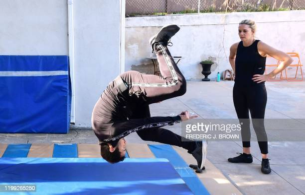 Stuntman Daniel Locicero demonstrates his technique doing flips for actress Courtney M Moore during a training session in Los Angeles California on...