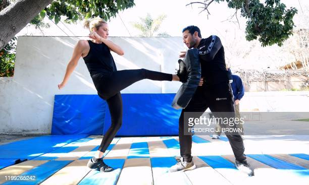 Stuntman Daniel Locicero works on kicking technique with actress Courtney M Moore during a training session in Los Angeles California on February 5...