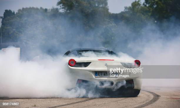 OLTREMARE NAPLES CAMPANIA ITALY Stuntman of the Franco Medici team they perform on a Ferrari 458 during the Motor Experience Naples International...