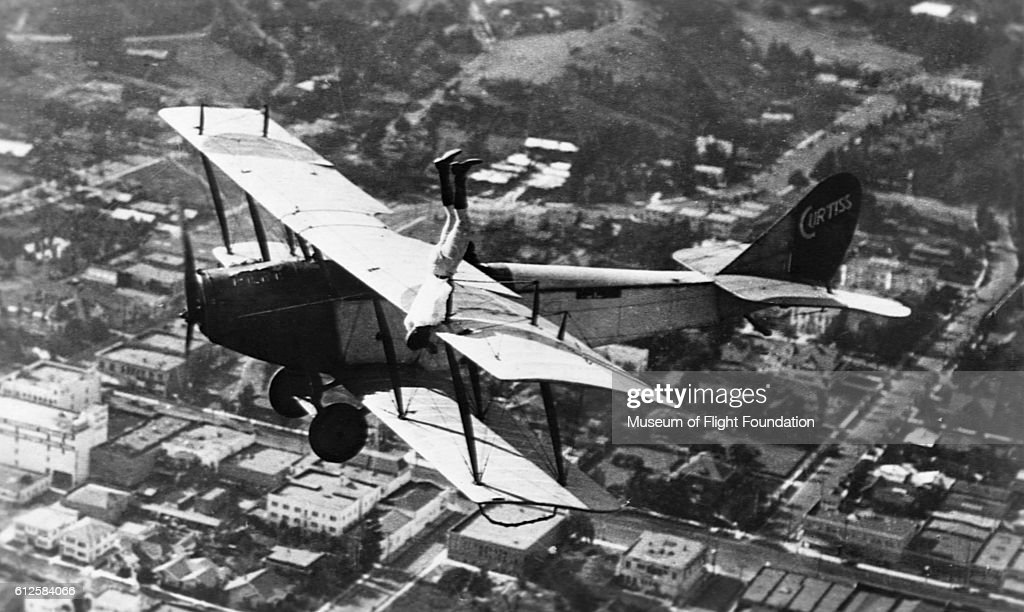 Stuntman Ormer Locklear, the first of the wing-walking barnstormers, does a handstand on the wing of a Curtiss JN-4D Jenny biplane in 1920. Locklear was killed in a movie stunt in the same year.