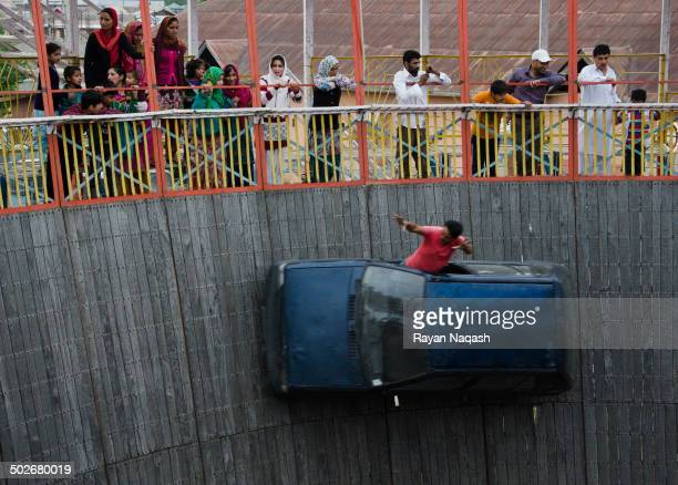 "Stuntman performs a motor stunt inside the ""well of death"" at the Kashmir Summer Tourism Festival in Srinagar, Jammu and Kasmir on 22 June 2014."