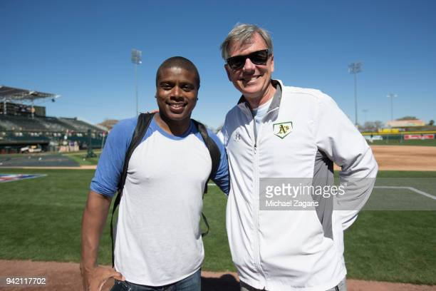 Stuntman Tony Todd from Black Panther stands on the field with Executive Vice President of Baseball Operations Billy Beane of the Oakland Athletics...