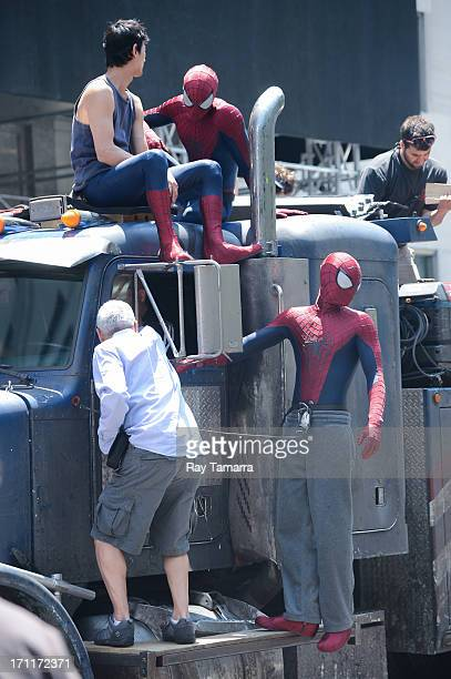 Stuntmen and actor Andrew Garfield film a scene at the 'The Amazing Spiderman 2' movie set in Madison Square Park on June 22 2013 in New York City