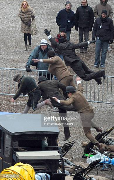 Stuntmen train on the set prior to the shooting of a scene of the 'Sherlock Holmes 2' movie in front of the cathedral of the French eastern city of...