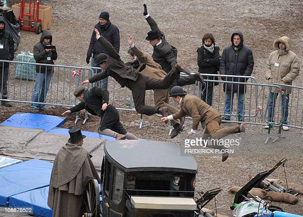 Stuntmen train on the set prior to the shooting of a scene of the Sherlock Holmes 2 movie in front of the cathedral of the French eastern city of...