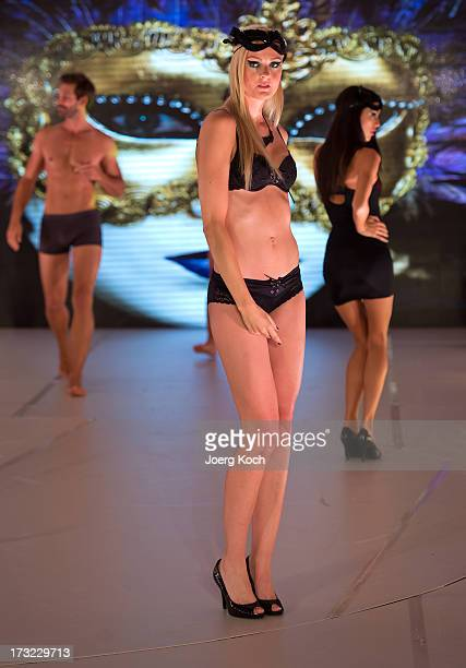 Stuntwoman Miriam Hoeller poses as a model at the Ernsting's Family Fashion Show Fall/Winter 2013 at Hotel Vier Jahreszeiten on July 10 2013 in...