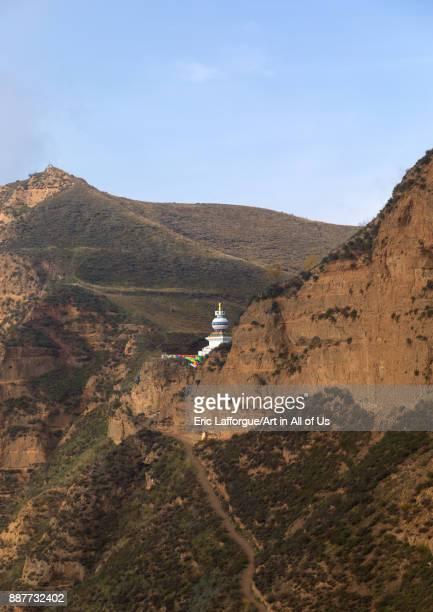 Stupa on a cliff in Shachong monastery Qinghai Province Wayaotai China on October 25 2017 in Wayaotai China