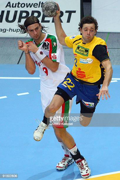 Sturla Asgeirsson of Duesseldorf throws a goal and Dennis Krause of Magdeburg can not stop him during the Toyota Handball Bundesliga match between...