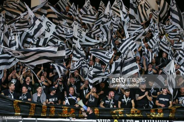 Sturm Graz fans wave flags as part of their choreography prior to kick off in the UEFA Europa League group B match between AS Monaco and Sturm Graz...