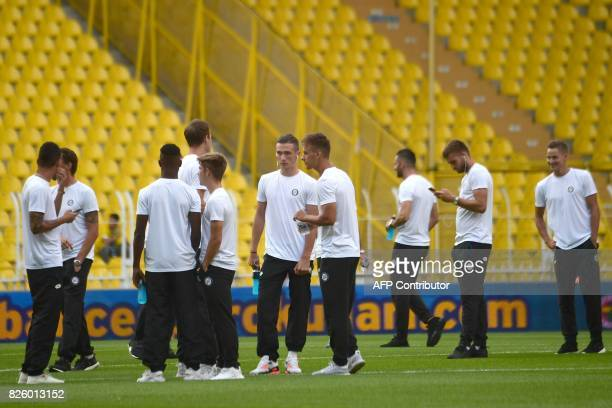 Sturm Graz' players arrive on the pitch before their UEFA Europa League third qualifying round second match against Fenerbahce on August 3, 2017 at...