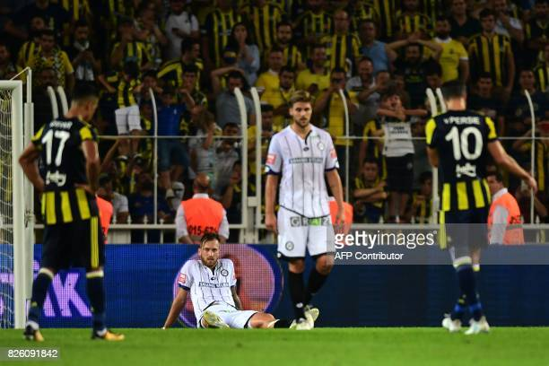 Sturm Graz' players react after the UEFA Europa League third qualifying round second match between Fenerbahce and Sturm Graz at Fenerbahce's Ulker...