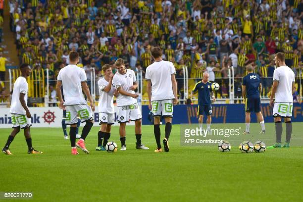 Sturm Graz' players warm up before their UEFA Europa League third qualifying round second match against Fenerbahce on August 3 2017 at Fenerbahce...