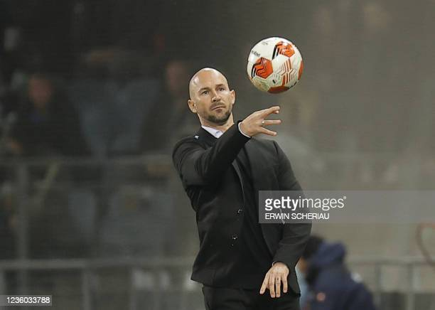 Sturm Graz's Austrian coach Christian Ilzer throws a ball during the UEFA Europa League group B football match between SK Sturm Graz and Real...