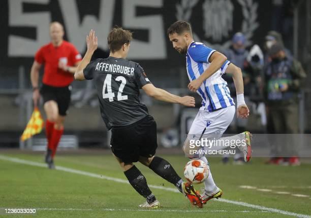Sturm Graz's Austrian defender David Affengruber and Real Sociedad's Belgian forward Adnan Januzaj vie for the ball during the UEFA Europa League...