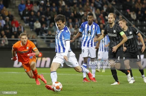 Sturm Graz's Austrian goalkeeper Jorg Siebenhaendl and Real Sociedad's Spanish midfielder David Silva vie for the ball during the UEFA Europa League...