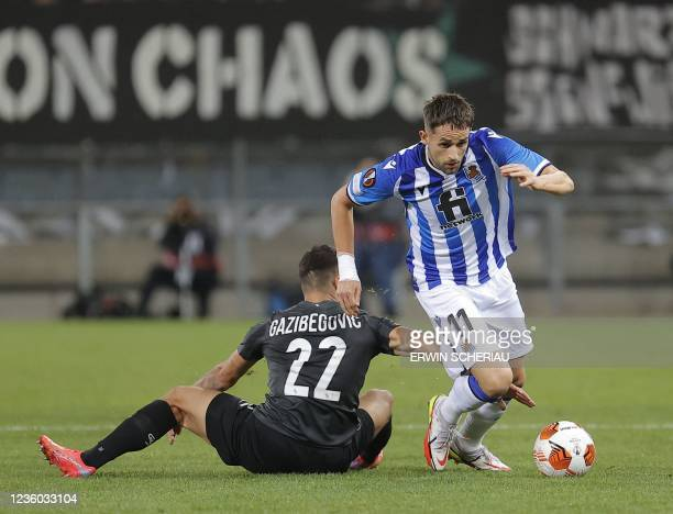 Sturm Graz's Bosnian defender Jusuf Gazibegovic and Real Sociedad's Belgian forward Adnan Januzaj vie for the ball during the UEFA Europa League...