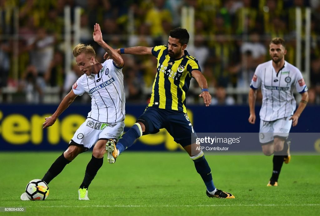 Sturm Graz`s James Jeggo (L) vies for the ball with Fenerbahce`s Alper Potuk (R) during the UEFA Europa League third qualifying round second match between Fenerbahce and Sturm Graz at Fenerbahce's Ulker Stadium in Istanbul on August 3, 2017. /