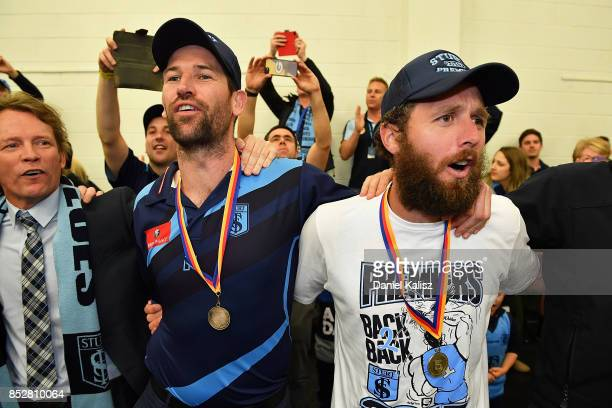 Sturt head coach Martin Mattner and Scott McMahon of Sturt sing the club song after defeating the Magpies during the SANFL Grand Final match between...