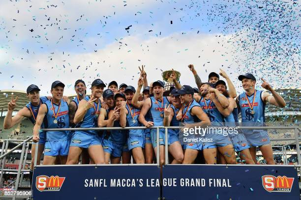 Sturt players pose for a photo with the winning Premiership Cup after defeating the Magpies during the SANFL Grand Final match between Port Adelaide...