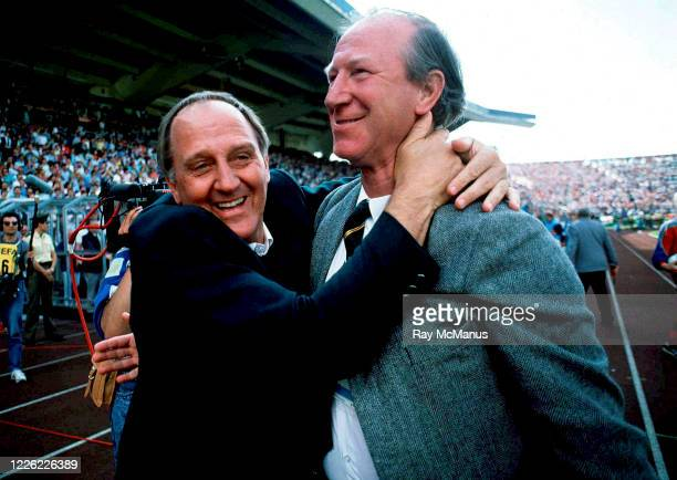 Stuttgart Germany 12 June 1988 Republic of Ireland manager Jack Charlton right and assistant manager Maurice Setters celebrate at the final whistle...