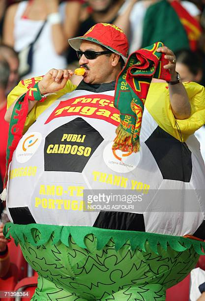 Portugal supporter cheers ahead of the start of the third-place playoff 2006 World Cup football match between Germany and Portugal at Stuttgart's...