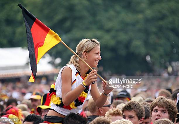 A supporters of the German national football team holds a German flag 08 July 2006 at the Fan Fest in Stuttgart a few hours before the beginning of...