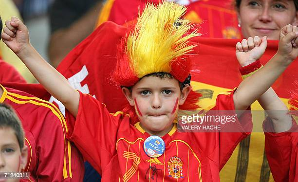 A young Spanish supporter cheers at Stuttgart's GottliebDaimler Stadium ahead of the start of the opening round Group H World Cup football match...