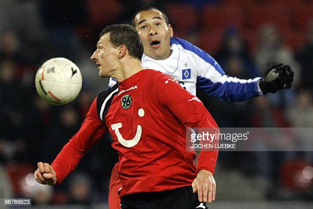 Hanover's Dariusz Zuraw from Poland vies against Hamburg's striker Naohiro Takahara from Japan, during their Bundesliga football match 08 February...