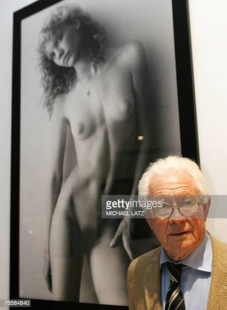 English photographer David Hamilton stands in front of one of his photographs taken in the late seventies at an exhibition of his work in Stuttgart...