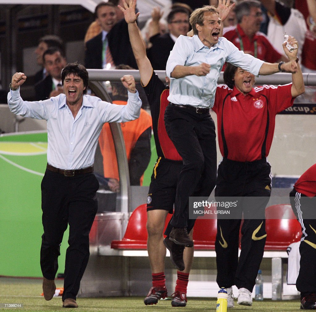 German assistant coach Joachim Loew (L) and German head coach Juergen Klinsmann (C) jump for joy after another goal by their side during the third-place playoff 2006 World Cup football match between Germany and Portugal at Stuttgart's Gottlieb-Daimler Stadium, 08 July 2006. Germany won the match 3-1.