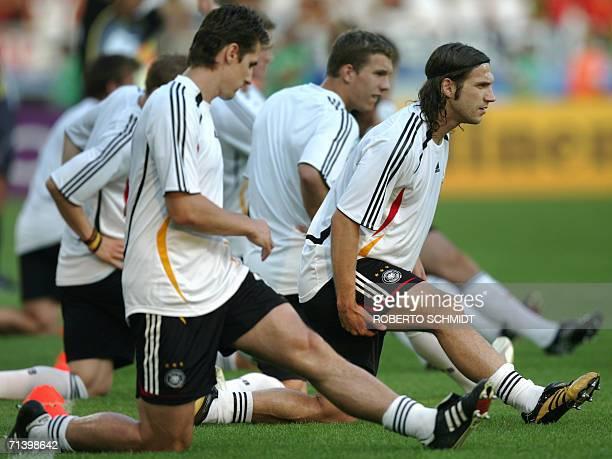 German forward Miroslav Klose , German forward Lukas Podolski and German midfielder Torsten Frings warm up before the start of the third-place...