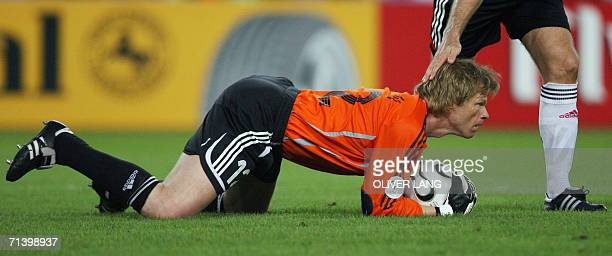 German goalkeeper Oliver Kahn grabs the ball for a save during the third-place playoff 2006 World Cup football match between Germany and Portugal at...