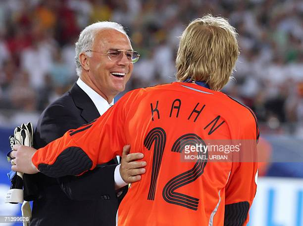 German goalkeeper Oliver Kahn is congratulated by German football legend and president of the World Cup organising committee Franz Beckenbauer...