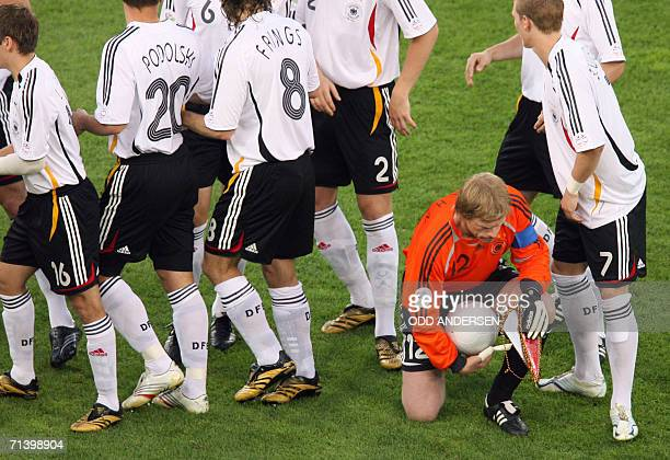 German goalkeeper Oliver Kahn is the last to get up after a team photo at the start of the third-place playoff 2006 World Cup football match between...