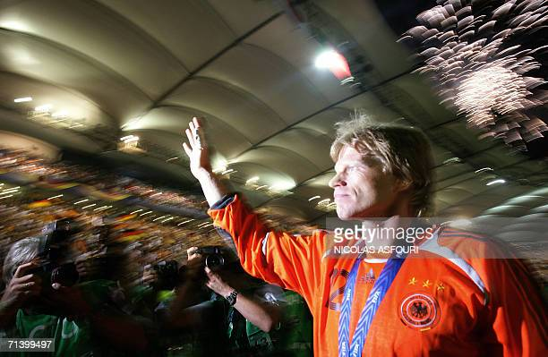 German goalkeeper Oliver Kahn waves to fans following their victory in the third-place playoff 2006 World Cup football match between Germany and...