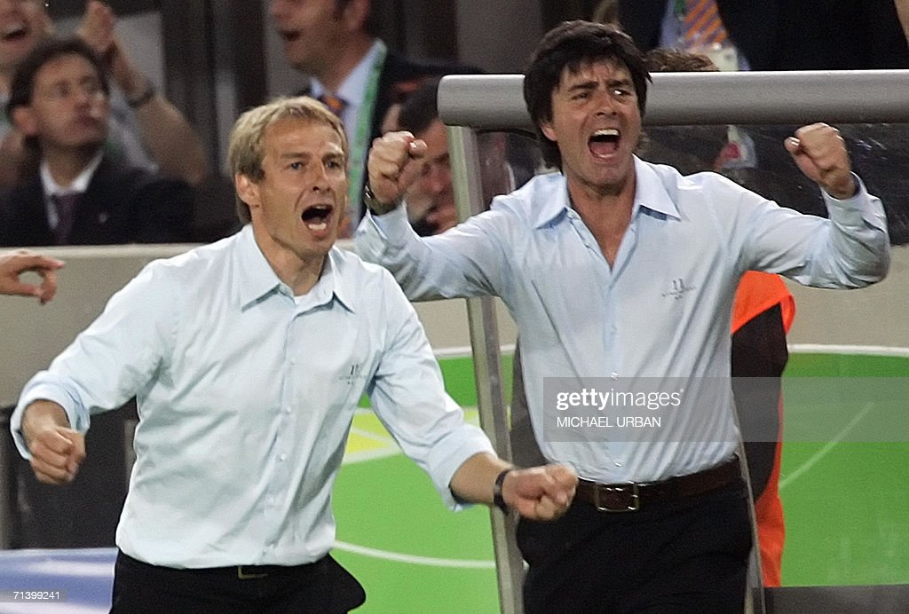 German head coach Juergen Klinsmann (L) and German assistant coach Joachim Loew (R) celebrates after German midfielder Bastian Schweinsteiger (not pictured) scored the third goal for his team during the World Cup 2006 third place play-off football game Germany vs. Portugual, 08 July 2006 in Stuttgart stadium.