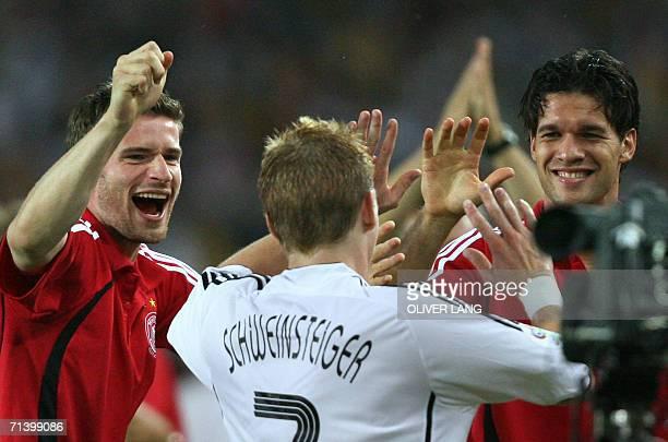 German midfielder Bastian Schweinsteiger celebrates his goal with German midfielder Michael Ballack and German defender Arne Friedrich during the...