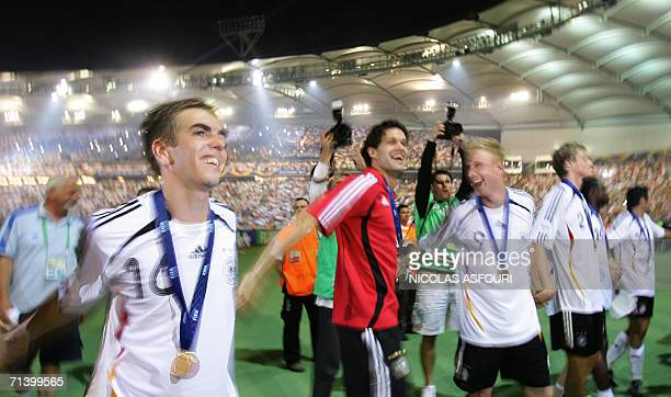 German players Philipp Lahm Michael Ballack Mike Hanke and Marcell Jansen celebrate after the World Cup 2006 third place playoff football game...