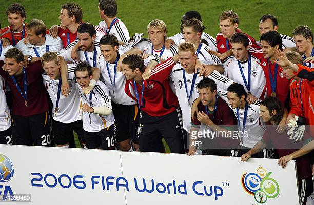 Members of the German team celebrate following the medal ceremony at the end of the thirdplace playoff 2006 World Cup football match between Germany...