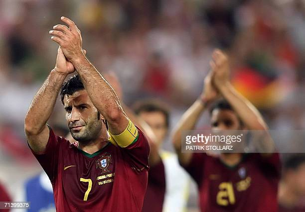 Portuguese forward Luis Figo and Portuguese forward Nuno Gomes applaud their fans at the end of the third-place playoff 2006 World Cup football match...