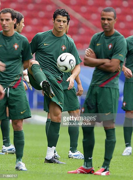 Portuguese striker Cristiano Ronaldo plays with a ball during a team training session in Stuttgart 07 July 2006 for the FIFA World Cup 2006 Portugal...