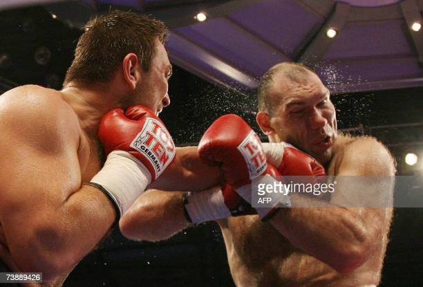Russia's Nikolay Valuev exchanges punches with Uzbek boxer Ruslan Chagaev during their WBA heavyweight title bout 14 April 2007 at the Porsche Arena...