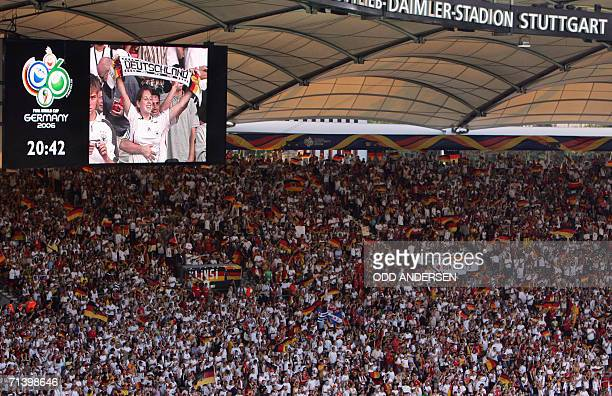 The crowd is pictured before the start of the third-place playoff 2006 World Cup football match between Germany and Portugal at Stuttgart's...