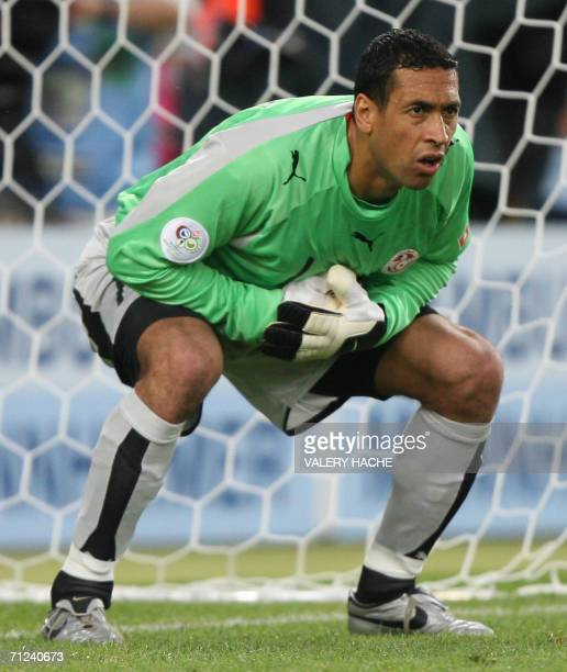 Tunisian goalkeeper Ali Boumnijel is seen in action during the opening round Group H World Cup football match between Spain and Tunisia at...