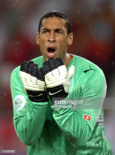 Tunisian goalkeeper Ali Boumnijel reacts during the opening round Group H World Cup football match between Spain and Tunisia at Stuttgart's...
