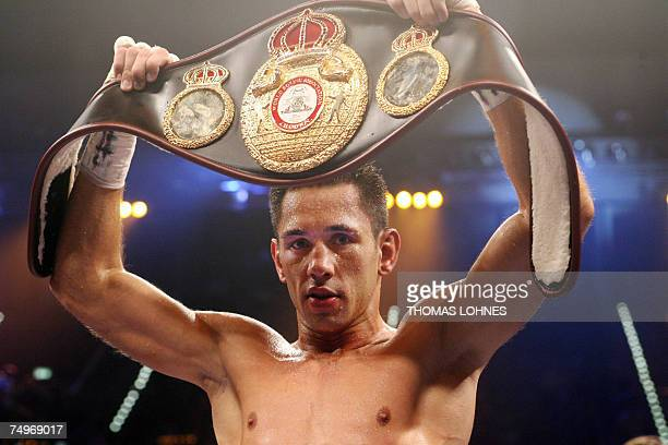 WBA middleweight champion Felix Sturm of Germany displays his belt after defeating Uruguay's Noe Tulio Gonzalez Alcoba during a bout in Stuttgart 30...