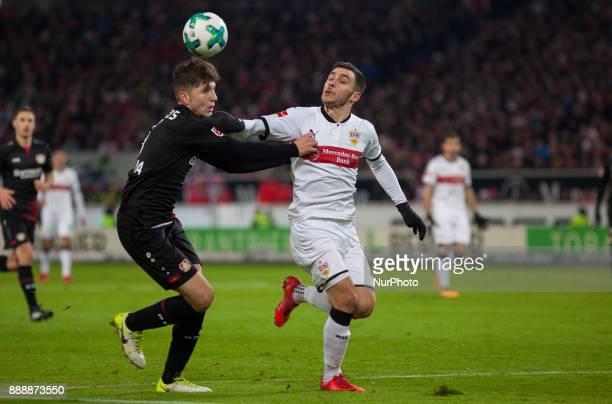 Stuttgarts Anastasios Donis in a duel with Leverkusens Panagiotis Retsos during the Bundesliga match between VfB Stuttgart and Bayer 04 Leverkusen at...
